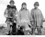 Group portrait of four Eskimos, three men and a woman, location unknown, ca. 1899