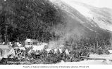 Klondikers with tents and log building, Sheep Camp, Chilkoot Trail, ca. 1898