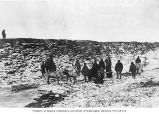 Group of people with reindeer drawn sleds, location unknown, ca. 1899