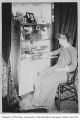 Edith Warner writing at a desk probably inside the Warner home in Seattle, 1890