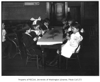 Classroom showing school children at a table including Ruth Warner,  Seattle, n.d.