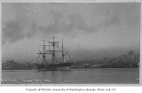 Full rigged sailing ship in Elliott Bay with a view of Seattle, ca. 1897