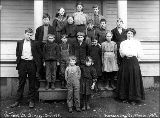School children stading in front of Cottage Lake School, King County, Washington, 1909
