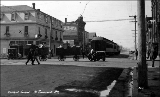 Street scene showing the Central Hotel and car of the Chicago, Milwaukee and St. Paul Railroad,...