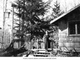 Edna McBride outside the Shady Glen cabin, Stillaguamish Country Club grounds, ca. 1935