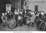 High school students and teacher in orchestra class, location unknown, n.d.
