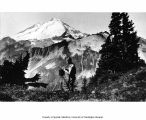 Photographer with camera in the vicinity of Mt. Baker, ca. 1930