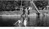 Children wading in lake, probably Spirit Lake near Mt. St. Helens, ca. 1950