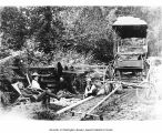 Three women and two men gathered around a picnic blanket alongside a carriage at Muck Creek, Mount...