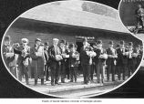 Excursion members holding fruit baskets at Stevenson train station, September 1908