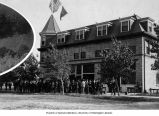 Group of men gathered outside hotel in Kennewick, September 1908