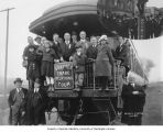 Businessmen and children standing on caboose of train in Chewelah, October 1920