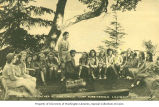 Girl Scouts gathering at the fire circle, Camp Robbinswold, Lilliwaup, n.d.