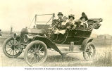 Family outing in a convertible automobile, n.d.