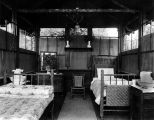 Qui Si Sana Sanatorium and Biological Institution showing open air cottage interior and hickory...