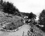 Louis Dechmann walking with two daughters, Louise and Marie, in the garden at the Qui Si Sana...