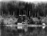 Qui Si Sana Sanatorium and Biological Institution, dock and cabins as seen from Lake Crescent, 1913