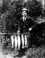 Man with fish catch, Qui Si Sana Sanatorium and Biological Institution, 1913