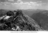 Summit of Mount Benzarino looking east with hiker in foreground, Washington, 1926