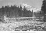 Mount Rainier and bridge crossing the Nisqually River, Mount Rainier National Park, ca. 1913
