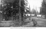 Log cabins in an unidentified railroad camp, Washington, ca. 1890