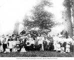 Group of men, women and children at a church social in Wildwood Park, Washington, 1900