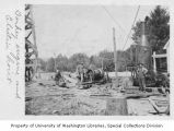 Washington State Capitol Temple of Justice construction site showing donkey engine and electric...