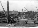 Construction begins on Insurance Building with Temple of Justice in background, Washington State...