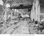 Workers cutting stone for Legislative Building, Washington State Capitol complex construction,...