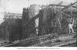Scaffolding and workers at Legislative Building construction site, Washington State Capitol group,...