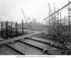 Construction progress on Legislative Building showing foundation pour forms, Washington State...