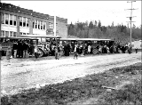 Children boarding buses outside of school, Redmond, Washington, ca. 1925