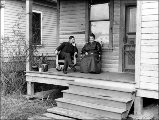 Iver and Clara Prestlien Botten on porch of Sarah Wold residence, Silvana, Washington, 1925-1930