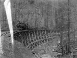 Northern Pacific Railway train on trestle during winter, Washington, ca. 1887