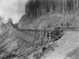 Men with handcar on Northern Pacific Railway trestle along hillside, Washington, ca. 1887