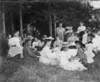Group of people having a picnic, ca. 1898-1899