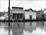 Flooded street in front of Iver Botten's general store in Silvana, Washington, ca. 1908-1914