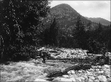 Man fishing in Stehekin River, Washington, ca. 1910.