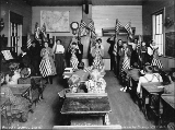 Children in classroom, unidentified school, King County, Washington, 1909