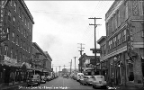 Street scene showing businesses and the Emerson Hotel on the left, Hoquiam, Washington, ca. 1949