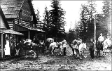 Packtrain at the Montegue and Moore store in Darrington, Washington, ca. 1905