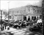 Automobiles gathered outside the Delmonico Hotel, Port Townsend, Washington, ca. 1914