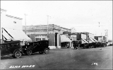 Street scene showing businesses and automobiles, Elma, Washington, ca. 1925