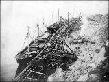 Barges being loading with sandstone from the Point Disney quarry, Waldron Island, Washington, ca....