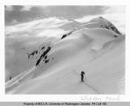 Skier on summit of Hidden Peak, n.d.
