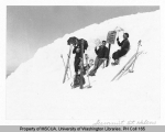 Three skiers carrying parasols resting on summit of Mt. St. Helens, n.d.