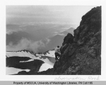 Mountaineer on Observation Rock on Ptarmigan Ridge, northwest slope of Mt. Rainier, n.d.
