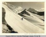 Skier traveling east past Coleman Creek and Camp Kizer region of Mt. Baker, n.d.