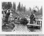 Jean Parker and movie crew filming The Barrier at lake below Heather Meadows Lodge, n.d.
