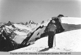 Hiker on Chickamin Glacier looking north toward South Cascade Glacier, 1939